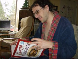 Tom looks at his new cookbook